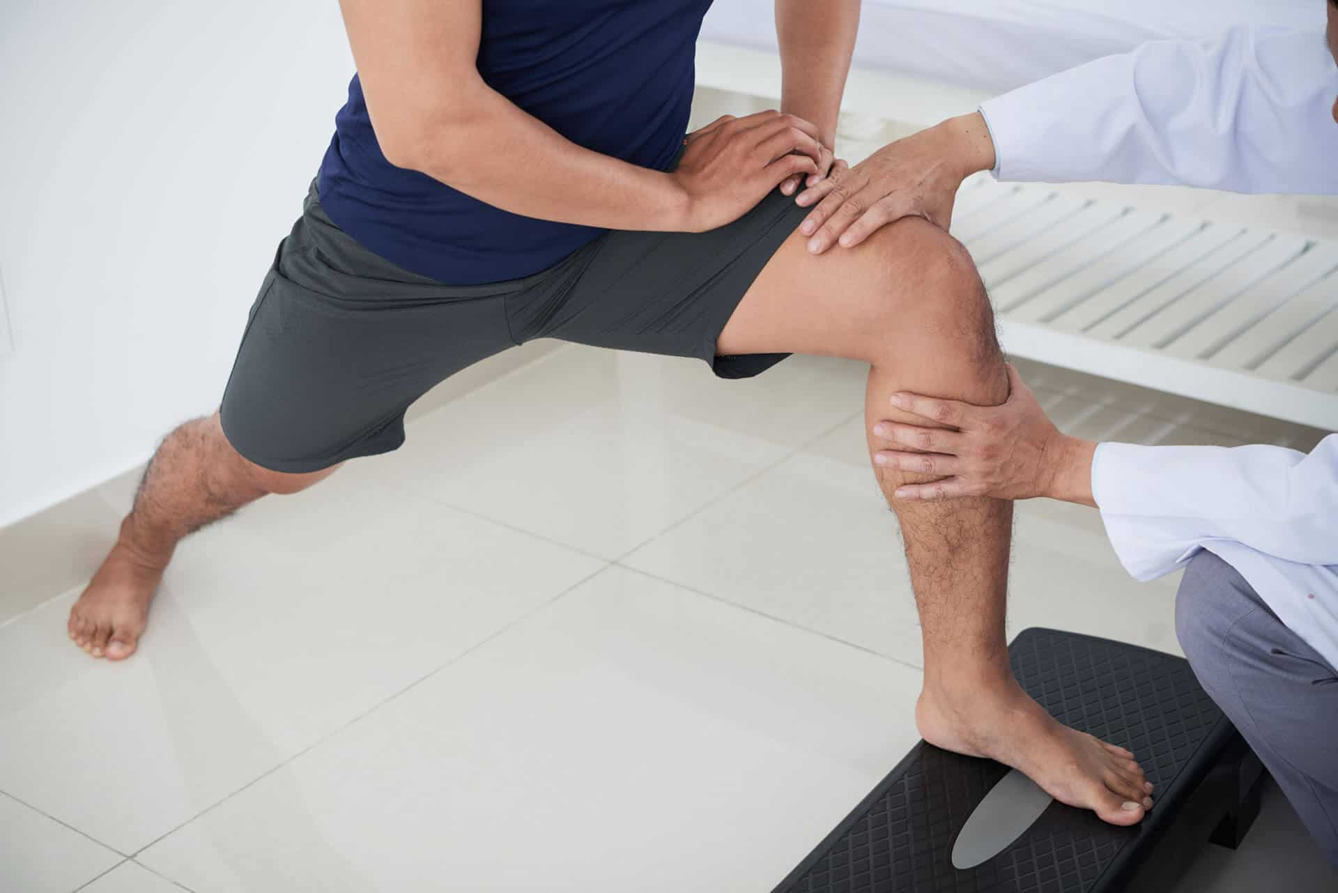 ortho doctor examining joint pain to a patient